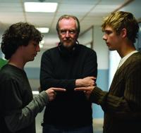 John Magaro, Max Thieriot and writer/director Wes Craven on the set of