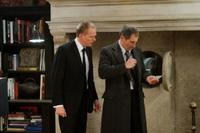 Paul Bettany as Interpol Agent Acheson and Timothy Dalton as Interpol Agent Jones in
