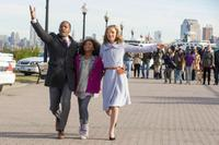 Jamie Foxx as Stacks, Quvenzhane Wallis as Annie and Rose Byrne as Grace in