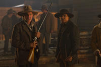 Harrison Ford as Colonel Dolarhyde and Adam Beach as Nat Colorado in