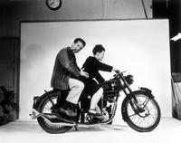 Charles Eames and Ray Eames on the set of