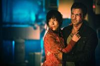 Yasmine Garbi as Miriam Wu and Paolo Roberto as Paolo Roberto in