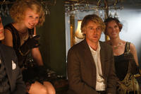 Alison Pill as Zelda Fitzgerald and Owen Wilson as Gil in