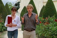Carla Bruni-Sarkozy as Museum Guide and Owen Wilson as Gil in