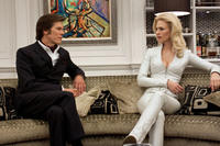 Kevin Bacon as Sebastian Shaw and January Jones as Emma Frost in
