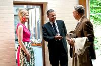 Rosamund Pike as Lisa Hopkins, Rupert Graves as Hopkins and Richard Schiff as Robert Tooley in