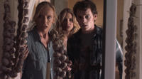 Toni Collette as Jane Brewster, Imogen Poots as Amy and Anton Yelchin as Charley Brewster in