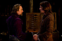 Gary Oldman as Father Solomon and Lukas Haas as Father Auguste in