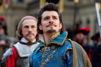 Christoph Waltz as Cardinal Richelieu and Orlando Bloom as Duke of Buckingham in