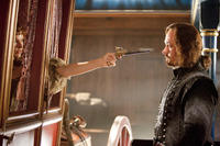 Milla Jovovich as Milady de Winter and Matthew MacFadyen as Aramis in