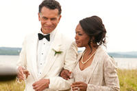 Brian Stokes Mitchell as Mr. Watson and Angela Bassett as Mrs. Watson in
