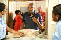 Tasha Smith, director Salim Akil and Loretta Devine on the set of