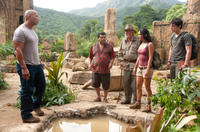 Dwayne Johnson as Hank, Luis Guzman as Gabato, Michael Caine as Alexander, Vanessa Hudgens as Kailani and Josh Hutcherson as Sean in