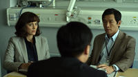 Marion Cotillard as Dr. Leonora Orantes and Chin Han as Sun Feng in