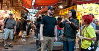 Director Steven Soderbergh, Chui Tien You and assitant Director Nikki Lau on the set of