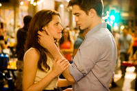 Kristen Stewart as Bella Swan and Robert Pattinson as Edward Cullen in