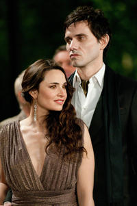 Mia Maestro as Carmen and Christian Camargo as Eleazar in