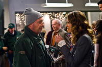 Hank Elizondo as Kominsky and Hilary Swank as Claire in