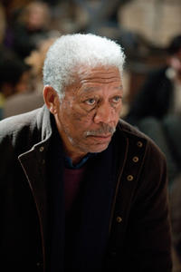 Morgan Freeman as Lucius Fox in