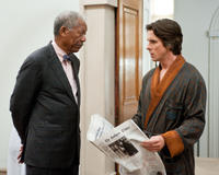 Morgan Freeman as Lucius Fox and Christian Bale as Bruce Wayne in