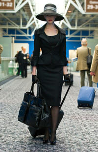 Anne Hathaway as Selina Kyle in