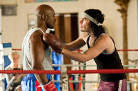 Evander Holyfield as Boxing Trainer and Russell Brand as Arthur in