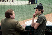 Jonah Hill and director Bennett Miller on the set of