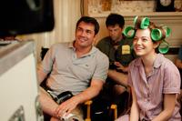 Director Tate Taylor, producer Brunson Grenn and Emma Stone on the set of