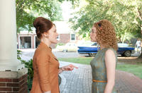Bryce Dallas Howard as Hilly Holbrook and Emma Stone as Skeeter Phelan in