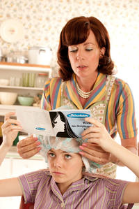 Emma Stone as Skeeter Phelan and Allison Janney as Charlotte Phelan in