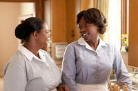 Octavia L. Spencer as Minny Jackson and Viola Davis as Aibileen Clark in
