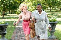 Jessica Chastain as Celia Foote and Octavia L. Spencer as Minny Jackson in