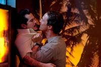 John Leguizamo as Val Valenzuela and Matthew McConaughey as Mickey Haller in