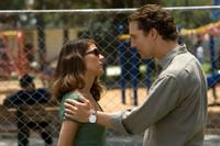 Marisa Tomei as Maggie McPherson and Matthew McConaughey as Mickey Haller in