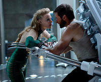Svetlana Khodchenkova as Viper and Hugh Jackman as Logan in