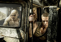 Nicholas Hoult as Nux, Abbey Lee Kershaw as Wag and Charlize Theron as Furiosa in