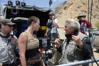 Charlize Theron and director George Miller on the set of
