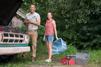 Kevin Costner as Jonathan Kent and Diane Lane as Martha Kent in