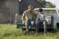 Kevin Costner as Jonathan Kent and Dylan Sprayberry as Clark Kent in