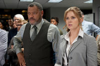 Laurence Fishburne as Perry White and Amy Adams as Lois Lane in