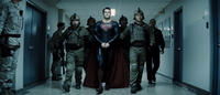 Henry Cavill as Superman and Christopher Meloni as Colonel Hardy in