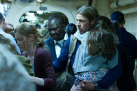 Mireille Enos as Karin Lane, Fana Mokeona as Thierry Umutoni and Brad Pitt as Gerry Lane in