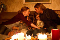 Mireille Enos as Karin Lane, Sterling Jerins as Constance Lane, Abigail Hargrove as Rachel Lane and Brad Pitt as Gerry Lane in
