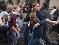 Mireille Enos as Karin, Sterling Jerins as Connie and Brad Pitt as Gerald Lane in
