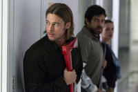 Brad Pitt as Gerry Lane, Pierfrancesco Favino as W.H.O. Doctor and Daniella Kertesz as Segen in
