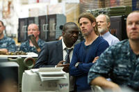 Fana Mokeona as Thierry Umutoni and Brad Pitt as Gerry Lane in