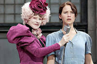 Elizabeth Banks as Effie Trinket and Jennifer Lawrence as Katniss Everdeen in