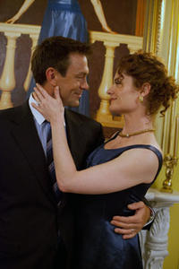 Rebecca Wisocky as Lillian Rearden and Grant Bowler as Henry Rearden in