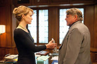 Taylor Schilling as Dagny Taggart and Graham Beckel as Ellis in