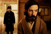 Craig Roberts as Oliver Tate and Noah Taylor as Lloyd in